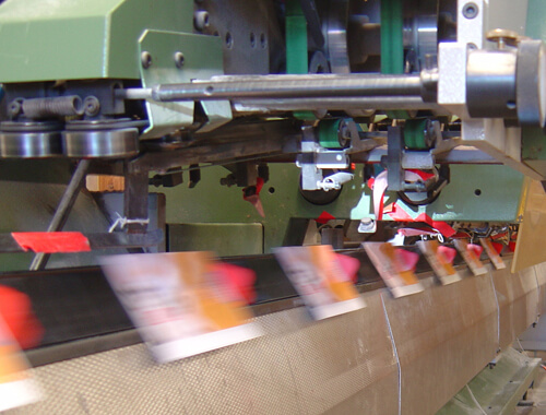 Saddle stitcher in action